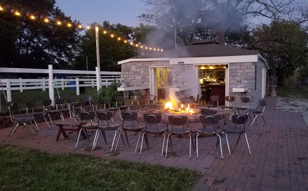 Outdoor Venue Rental at Saddle Creek Stables includes large BBQ fire pit, and patio area